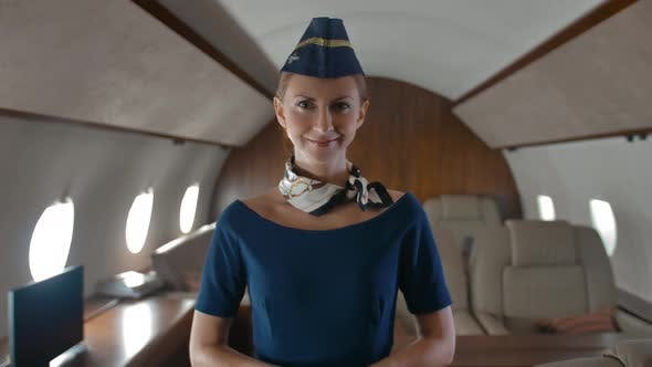 Thumbnail for Portrait of Young Stewardess Inside of Private Jet Cabin.