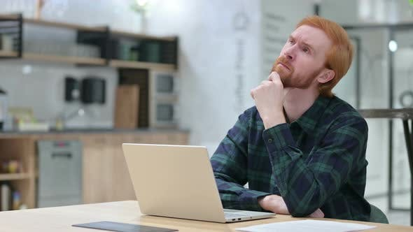 Thumbnail for Beard Redhead Man with Laptop Thinking in Cafe