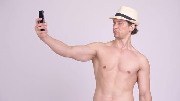 Thumbnail for Handsome Muscular Tourist Man Taking Selfie Shirtless