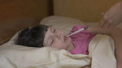 A Child with a Thermometer.
