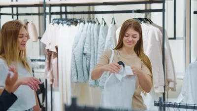 Women Choosing Shirt in Clothes Store