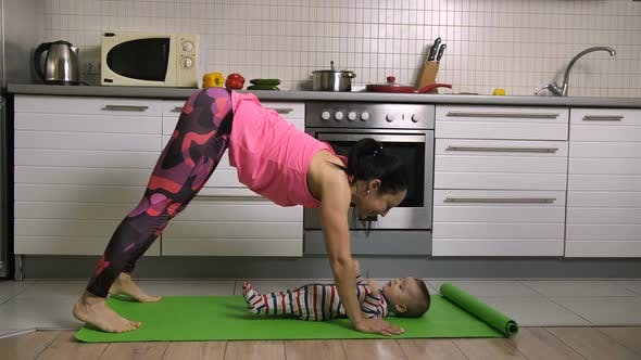 Thumbnail for Fit Female Doing Yoga Together with Baby at Home