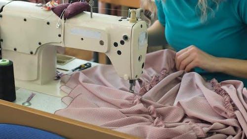 Female Dressmaker Working on the Sewing Machine