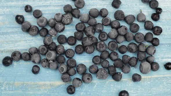 Thumbnail for Timelapse Footage of Freezing Fruits, Berries on Blue Surface. Frozen Food. Frosting of Blueberry