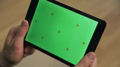 Male Hands Holding Ebook with Green Screen. Closeup Tablet with Chromakey Screen
