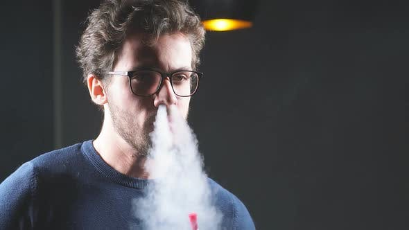 Caucasian Awesome Man Is Blowing Smoke.