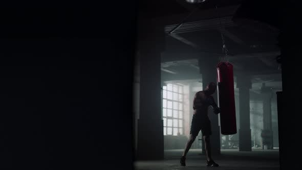 Man Fighting with Punch Bag
