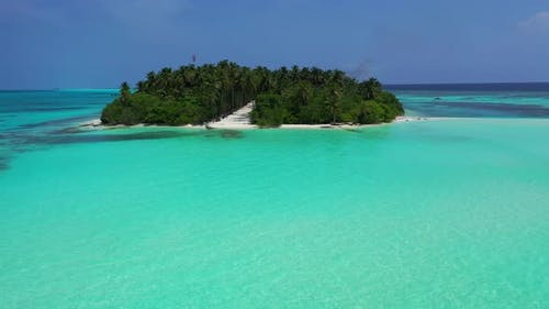 Wide angle overhead travel shot of a summer white paradise sand beach and blue sea background in hi