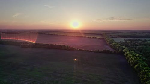 Beautiful Sunset Sky Over a Green Meadows