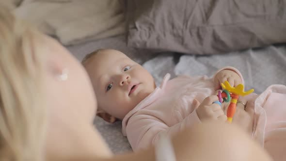 Thumbnail for A Cute Baby Girl Lying on a Back and Smiling To Her Mother