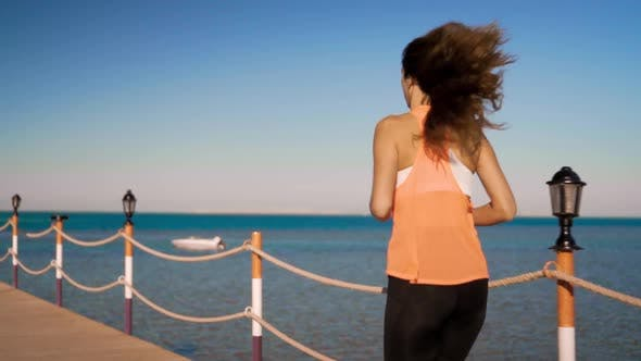 Thumbnail for The Beautiful Girl Runs Along at Sunset