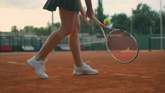Thumbnail for Slow-motion Side View of a Young Athlete Trains the Serve of the Tennis Ball. A Teenage Athlete