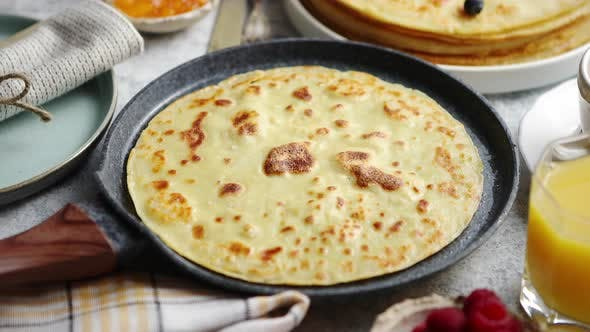 Thumbnail for Healthy Homemade Pancake on Stone Frying Pan Placed on Table
