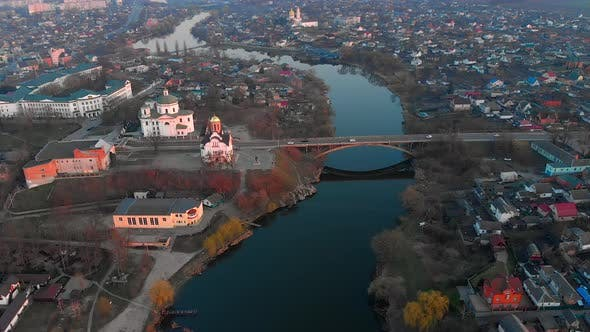 Thumbnail for Aerial Shot of Bridge Above River and Two Churches in Small European City