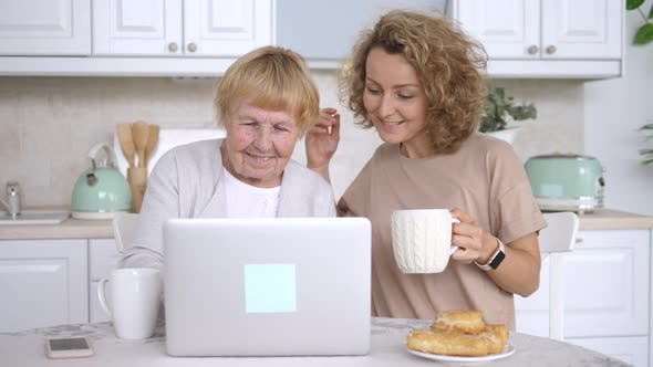 Elderly People, Family Care And Technology Concept. Learning New Technology. Grandmother And