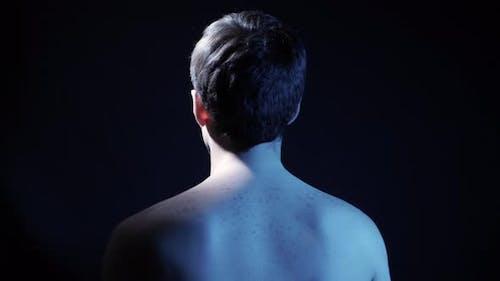 Man Spins at Dark Room, Looped