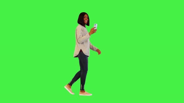 Cheerful Afro Girl Blogger Walk Taking Photos on Smartphone Camera for Social Media Happy Smiling on