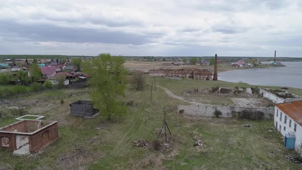 Thumbnail for Aerial view of old brick ruined building with a brick pipe and others ruined buildings