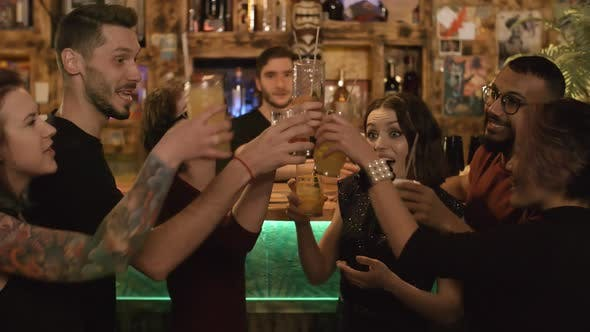 Thumbnail for Cheerful Multiethnic Friends Partying at Bar