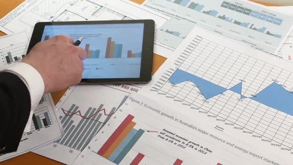 Thumbnail for Business People Developing a Business Project and Analyzing Market Data Information