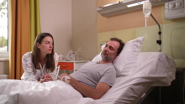 Thumbnail for Sad Woman Crying at Sick Husband's Bedside in Ward