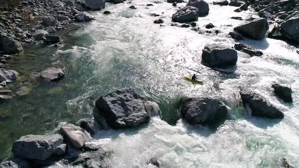 Thumbnail for Whitewater Kayaking Rocky Drop Slow Motion Aerial