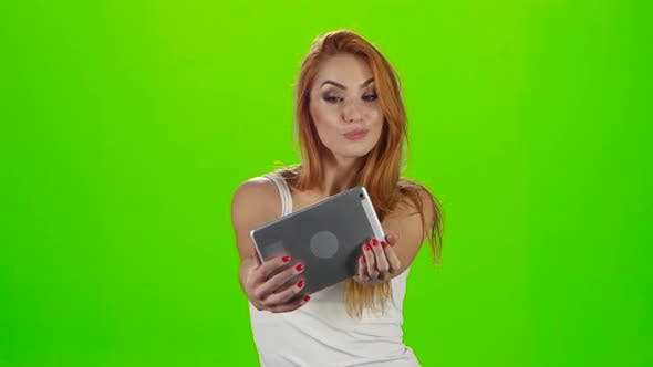 Thumbnail for Redheaded Model Grimaces on Camera a Tablet