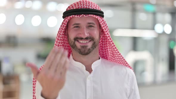Thumbnail for Assertive Arab Businessman Pointing with Finger and Inviting