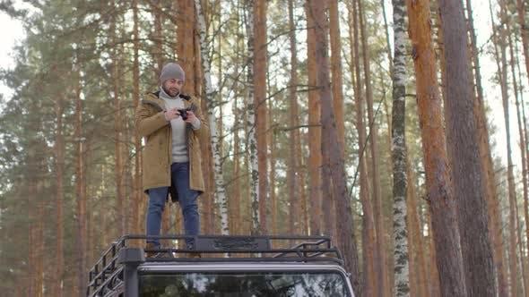 Thumbnail for Man Making Shots Outdoors