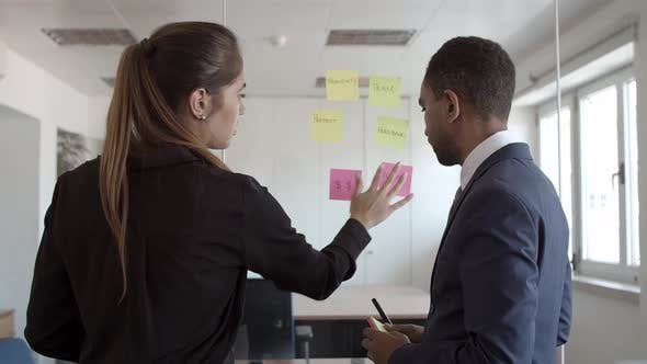 Thumbnail for Business Colleagues Working Together, Sticking Memos