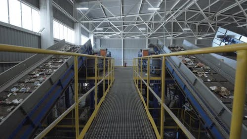 Waste Sorting Plant Conveyors Filled with Various Household Waste