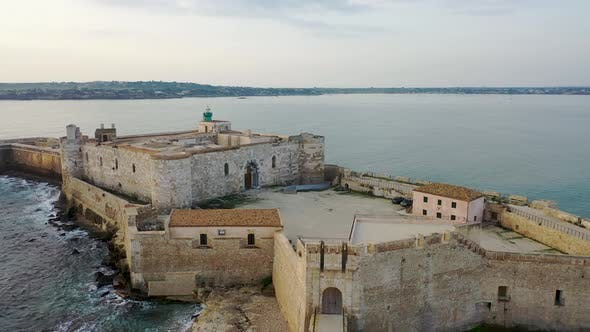 Thumbnail for View of the Embankment of the Island of Ortigia During Sunrise. Bird's Eye View. Sicily. Italy
