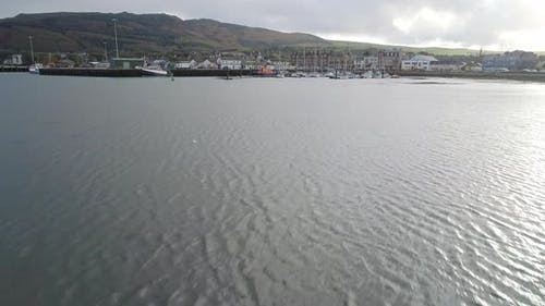 Skimming over the loch towards Campbeltown marina and old quay