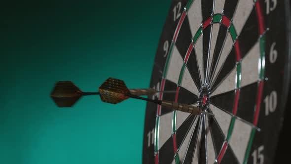 Thumbnail for 2 shots of darts hitting board in slow motion; shot on Phantom Flex 4K at 1000 fps