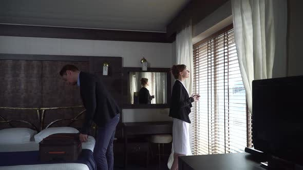Thumbnail for Adult Man and Woman Arrived in Modern Hotel. Girl Comes To the Window and Look on It, Man Joins Her