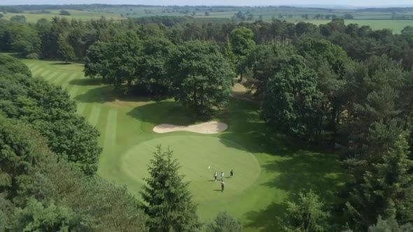 Golfers on the Green of a Golf Course Aerial View