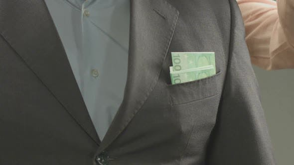 Thumbnail for Woman's hand taking euros from husband's jacket pocket, loss of money, closeup