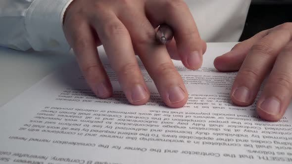 Businessman Sign Signature on Document Contract Paper at Office Desk
