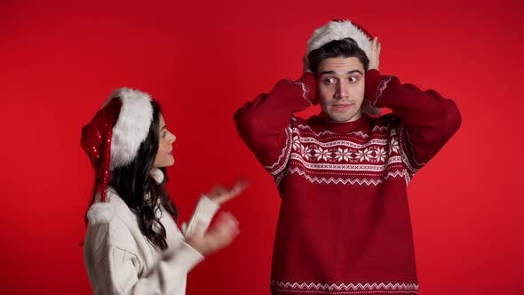 Thumbnail for Young Woman in Christmas Hats Emotionally Screaming at Her Boyfriend on Red