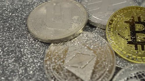 Cryptocurrencies Lie on Silver Sequins