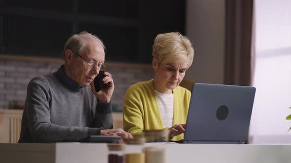 Old Man and Woman are Shopping Online Doing Order in Internet Shop Calling to Callcenter for