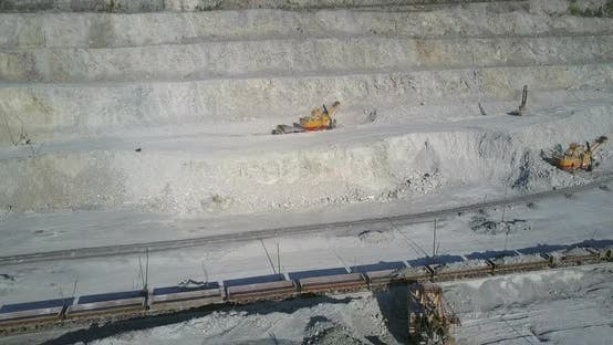 Thumbnail for Big Power Digger Operates Loading Ore Train with Asbes
