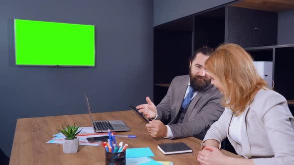 Thumbnail for Man Sends Information From His Tab To TV with Green Screen