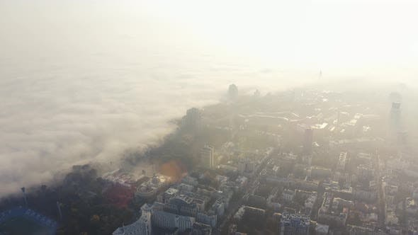 Thumbnail for Metropolis in Foggy Weather. The Big City Is Covered in Fog at Dawn. Fog in Kiev, Ukraine