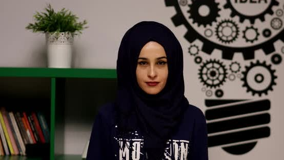 Cover Image for Young Woman Muslim Looking Camera