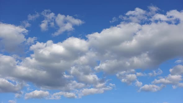 Thumbnail for Time-lapse, Beautiful clouds high in the blue sky. White and blue colors of nature in the heaven