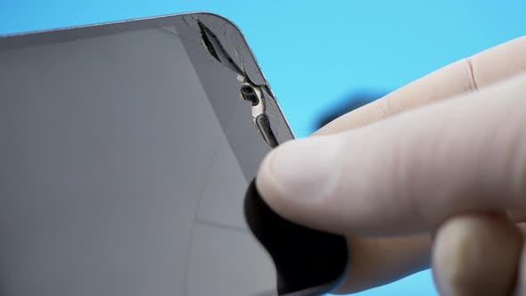 Thumbnail for Technician Looking for Broken Screen on Smartphone