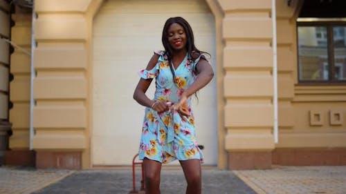 Smiling Afro Girl Dancing Bachata City