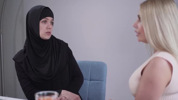 Thumbnail for Portrait of Anxious Muslim Woman Talking with Unrecognizable Blond Caucasian Woman