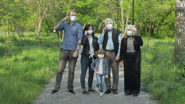 Large Family in Park Takes Off Medical Masks After Coronavirus Quarantine End